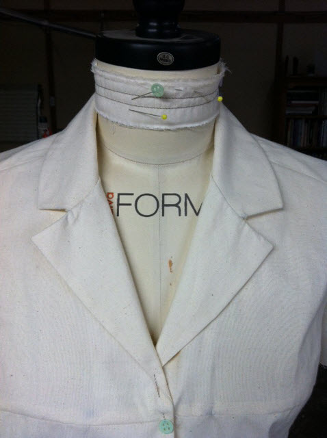 The front collar and or neckline. We need to see how the collar is laying.